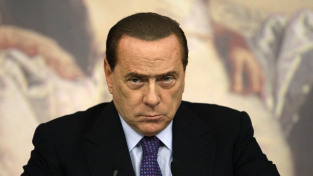 Italian Prime Minister Silvio Berlusconi attends a news conference at Chigi palace in Rome