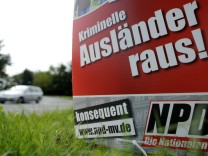 An election poster reading: 'Criminal Foreigners Out!' of German far-right National Democratic Party (NPD) is pictured in Schwerin.
