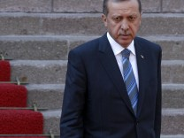 Turkey's Prime Minister Tayyip Erdogan attends a welcoming ceremony in Ankara