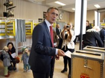 Norwegian PM Stoltenberg puts his ballot in the ballot box at the Uranienborg school polling station during the local elections in Oslo