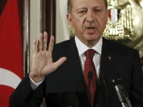 Turkey's Prime Minister Recep Tayyip Erdogan speaks during a news conference in Cairo