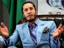 File photo of Saadi Gaddafi, the third son of Libya's Muammar Gaddafi, reacting to a question at a news conference in Sydney