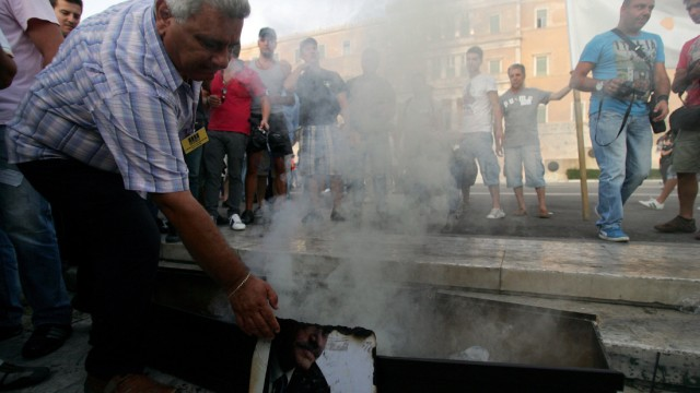 Taxi owners staged a protest march to the Greek Parliament in Ath