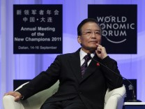 China's Premier Wen Jiabao listens to a question at the opening ceremony of WEF in Dalian