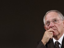 German Finance Minister Schaeuble reacts during International Meeting of Prayer for Peace in Munich