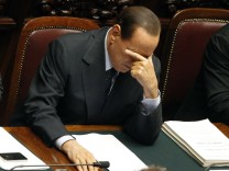 Italy's Prime Minister Silvio Berlusconi reacts during a debate in the upper house of parliament in Rome