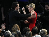 Kate Winslet reacts after her co-star Guy Pearce won outstanding supporting actor in a miniseries or movie for 'Mildred Pierce' at the 63rd Primetime Emmy Awards in Los Angeles