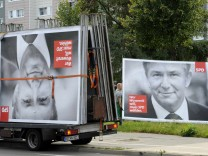 Workers remove election placards of Berlin's Social Democratic mayor Klaus Wowereit in Berlin.