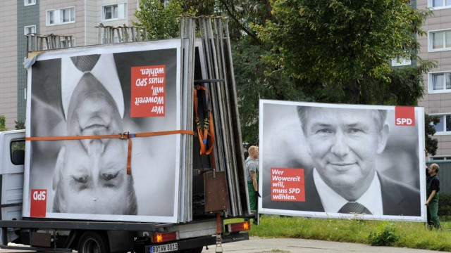 Workers remove election placards of Berlin's Social Democratic mayor Klaus Wowereit in Berlin.