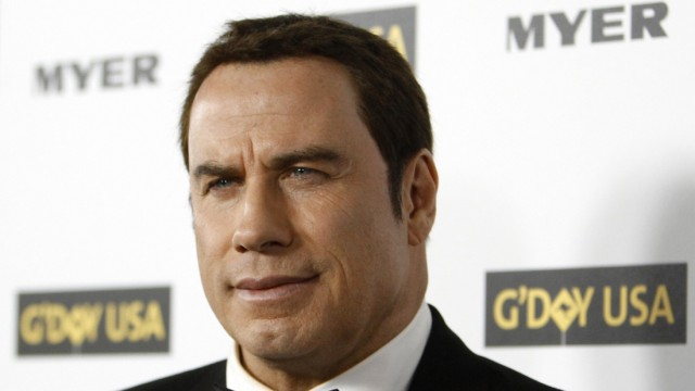 Travolta poses at the G'Day USA 2010 Los Angeles gala in Hollywood
