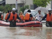 A family is rescued from a flooded area in Nagoya