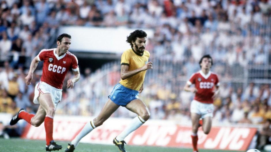 1982 World Cup Finals. Seville, Spain. 14th June, 1982. Brazil 2 v USSR 1. Brazil's Socrates out-runs USSR's Tengiz Sulakvelidze for the ball.