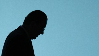 File picture of Swiss bank UBS CEO Gruebel as he is silhouetted walking on stage prior the start of the general shareholders meeting in Zurich