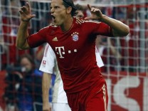 Van Buyten of Bayern Munich celebrates after scoring during the German first division Bundesliga soccer match against Bayer 04 Leverkusen in Munich