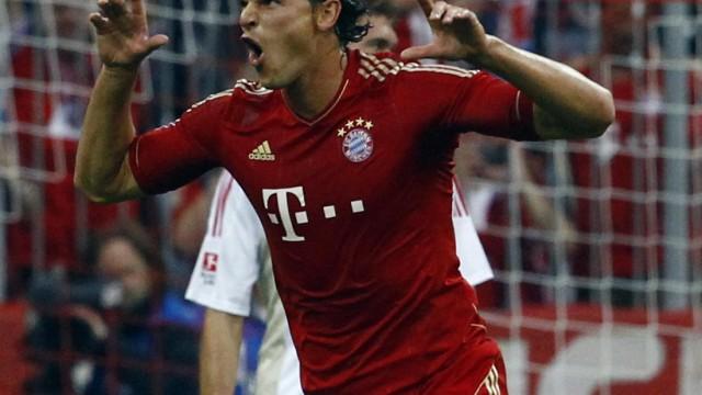 Van Buyten of Bayern Munich celebrates after scoring during the German first division Bundesliga soccer match against Bayer 04 Leverkusen in Munich