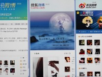 Various Chinese microblog websites are seen on a screen in this photo illustration taken in Beijing