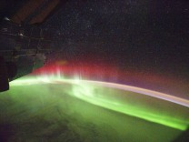 A NASA photograph shows rare aurora appearing in red
