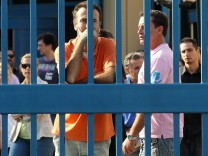 Employees of the Greece Transport Ministry block the gates in Ath