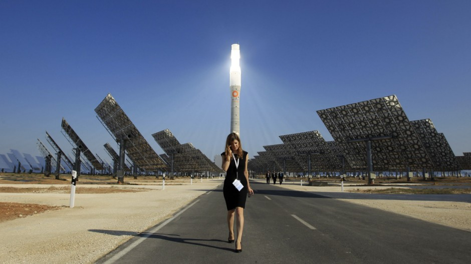 A woman walks at the new solar power plant 'Gemasolar' the day of its inauguration in Fuentes de Andalucia