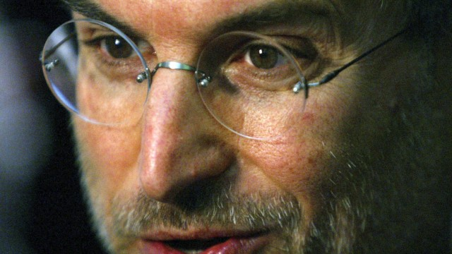 File photo of Apple CEO Steve Jobs speaking to the media at the launch of the European iTunes online music store in London