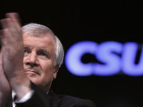 Bavarian Prime Minister Seehofer gestures during CSU party convention in Nuremberg