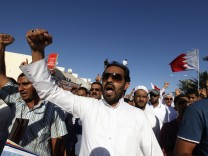 Family members and supporters shout anti-government slogans during a funeral procession held in Budaiya, west of Manama