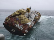 The 47,230 tonne Liberian-flagged Rena lists in heavy swells, about 12 nautical miles (22 km) from Tauranga