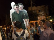 Israeli activists carry cardboard cut-outs of captured Israeli soldier Gilad Shalit in Jerusalem