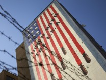 An anti-U.S. mural is seen on a wall of a government building in central Tehran