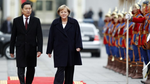 Germany's Chancellor Merkel and Mongolian PM Batbold attend an official welcoming ceremony in Ulan Bator