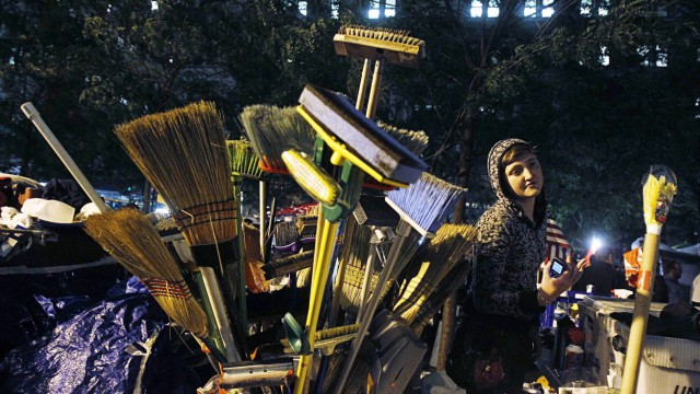 An Occupy Wall Street campaign demonstrator stands near cleaning supplies in Zuccotti Park