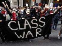 Occupy Boston protestors shout slogans outside the Bank of America building in Boston