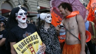 Protestors with Occupy San Francisco take part in a demonstration on the streets of San Francisco