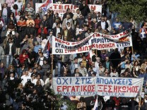 People take part in an anti-austerity rally in Athens' Syntagma square