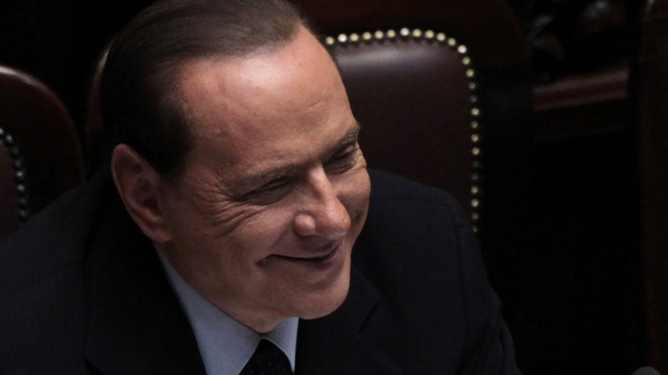 Italy's Prime Minister Silvio Berlusconi smiles during a debate at the Parliament in Rome