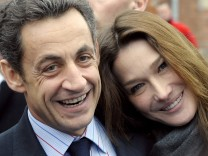 File photo of France's President Sarkozy and Carla Bruni-Sarkozy posing before visiting a hospital in Creteil near Paris