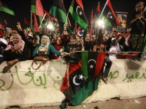 People celebrate at Martyrs' Square in Tripoli