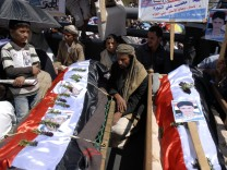 Mourners attend a rally to demand the ouster of Yemen's President Ali Abdullah Saleh in Sanaa