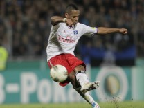 HSV Hamburg's Aogo scores a goal by a free kick against Eintracht Trier in extra time during their DFB second round German soccer cup (DFB Pokal) match in Trier