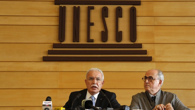 Palestinian Foreign Minister al-Malki and Palestinian ambassador to UNESCO Sanbar attend a press conference during the 36th session of UNESCO's General Conference in Paris