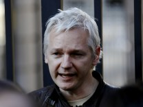 WikiLeaks founder Julian Assange speaks to protesters outside St Paul's Cathedral in central London
