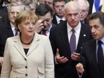 Angela Merkel, Nicolas Sarkozy, George Papandreou