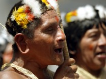 Ecuadorean Huaorani Indians shout slogans during protest in Quito