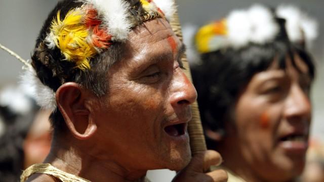Ecuadorean Huaorani Indians shout slogans during protest in Quito