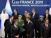 G20 leaders take part in a family photo during the G20 Summit of major world economies in Cannes