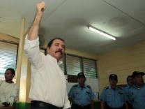 Daniel Ortega, Nicaragua's current president and presidential candidate from the ruling Sandinista National Liberation Front, shows ink-stained finger after casting his vote during presidential elections at a polling station in Managua