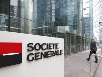 File photo of an employee entering the headquarters of French bank Societe Generale at La Defense, west of Paris