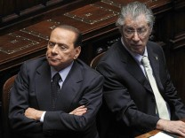 Italy's PM Berlusconi and Minister of Federal Reforms Bossi attend a session at the Parliament in Rome