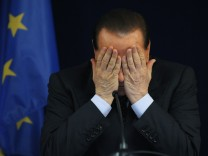 File photo of Italy's Prime Minister Berlusconi addressing a news conference at the end of a EU summit in Brussels