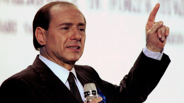 File photo of Berlusconi, leader of Italy's right-wing Forza Italia (Go Italy) party, speaking at a rally to close his party's campaign